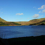 """Dog Walking in Dovestone Reservoir by oatsy40 licensed under CC BY 2.0"""