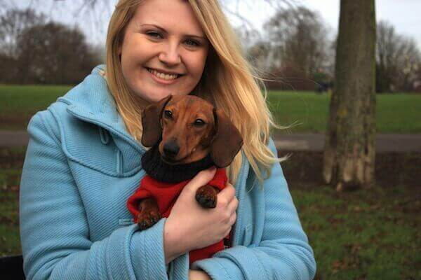 George the Dachshund with his borrower. BorrowMyDoggy can help socialise anxious dogs like George.